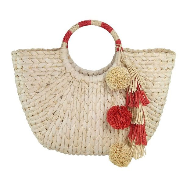 Hoop-handle straw tote with poms and tassels
